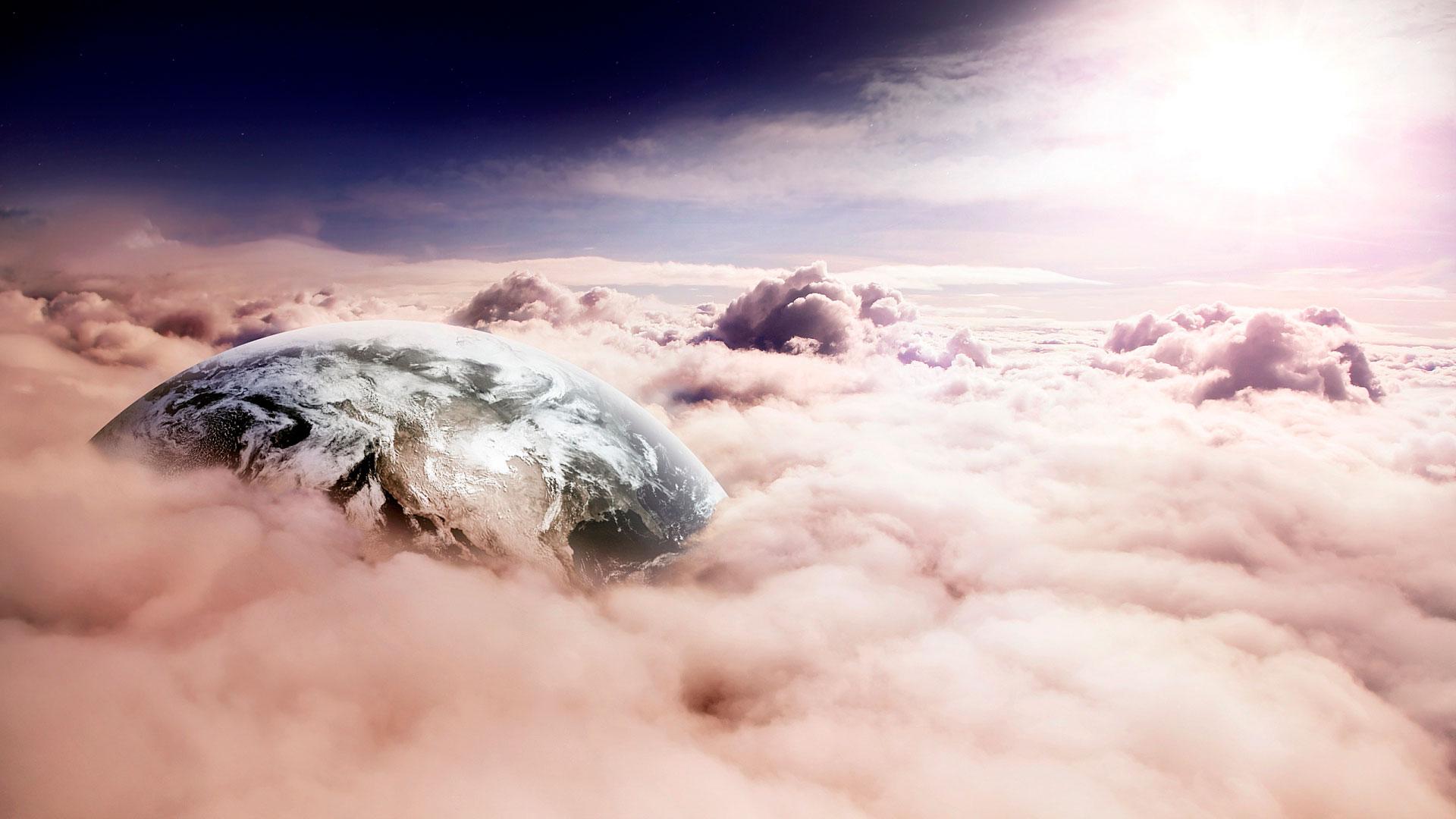 Обои планета между облаками для